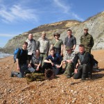Group of primitive coastal hunter gatherers on a coastal bushcraft course