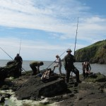 Fishing off the rocks on a coastal bushcraft course.