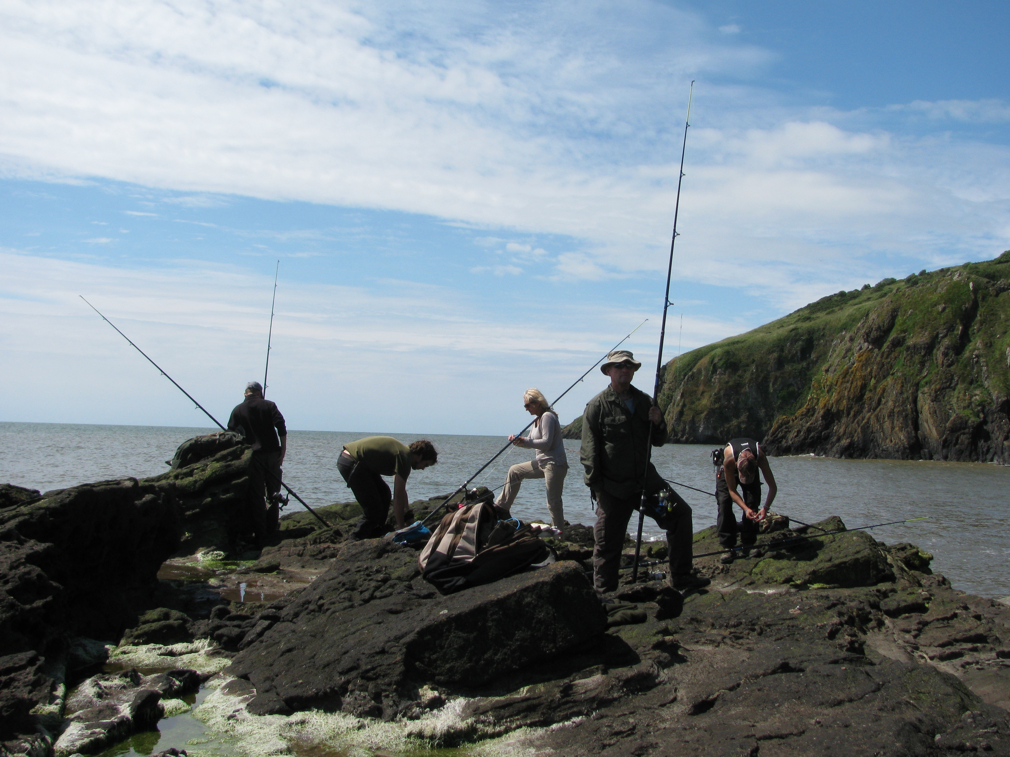 Fishing off the rocks on a coastal bushcraft course.