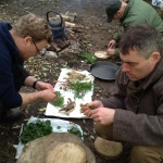 Group cooking on camp fire on a bushcraft course