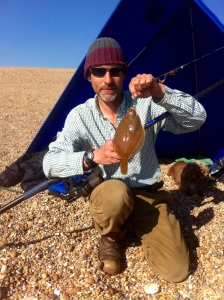 Catching fish from the beach along tbe seashore in West Dorseton a bushcraft course in the uk.