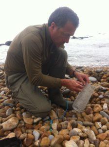 Coastal survivor making traps from beach rubbish